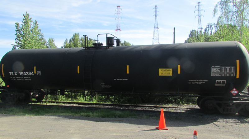 by: MARK MILLER - An older-model DOT-111 tanker car sits on the tracks in Portland. The car, along with another model built to improved design standards adopted in 2011, served as a demonstrator at a rail safety event in the Linnton neighborhood Tuesday, April 29.