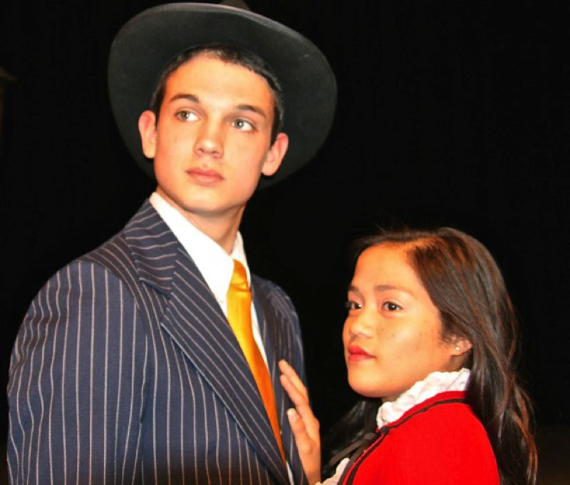 by: SUBMITTED PHOTO: NINA WILLIAMS - Sky Masterson, a big-city gambler played by THS sophomore Jonathan Irving, and Sarah Brown, the sergeant in charge of the Save-a-Soul Mission played by junior Jezeth Zaragoza, have very different moral values when they first meet, but inevitably, opposites attract.