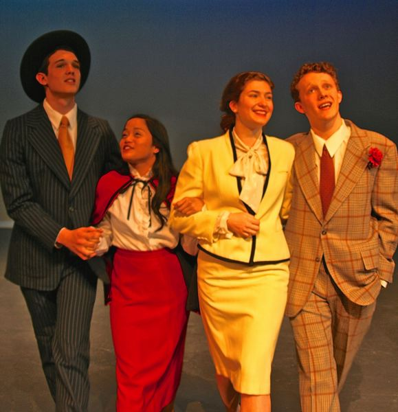 by: SUBMITTED PHOTO: NINA WILLIAMS - These 'Guys and Dolls' ready for a night on the town include (from left) Tigard High sophomore Jonathan Irving as Sky Masterson, junior Jezeth Zaragoza as Sarah Brown, sophomore Mary Graham as Miss Adelaide and senior Paul Harestad as Nathan Detroit.