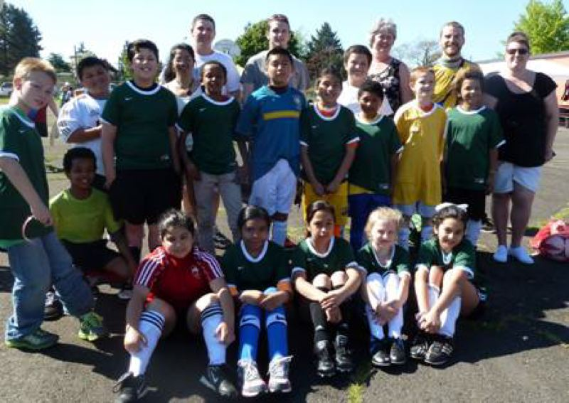 by: CONTRIBUTED PHOTO: METROPOLITAN FAMILY SERVICE - Students stop for a picture during last year's Cinco de Soccer event.