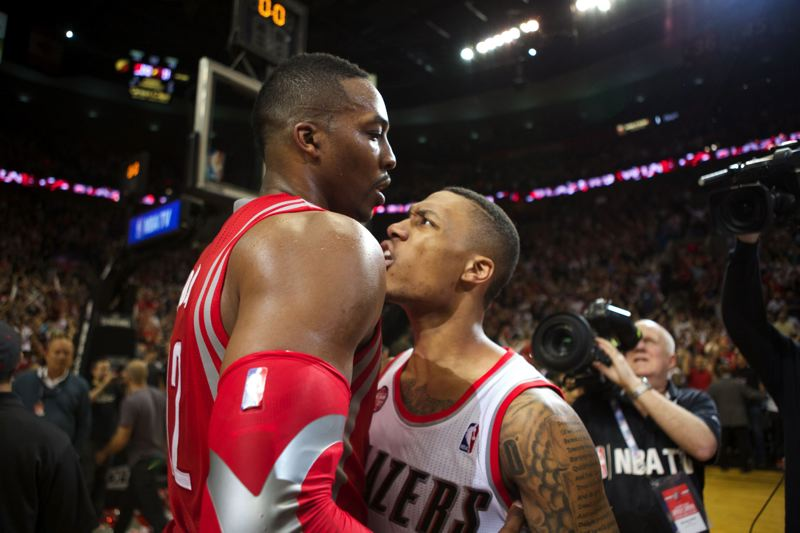 Houston center Dwight Howard congratulates Trail Blazers guard Damian Lillard after Lillard's series-winning 3-pointer at the buzzer.