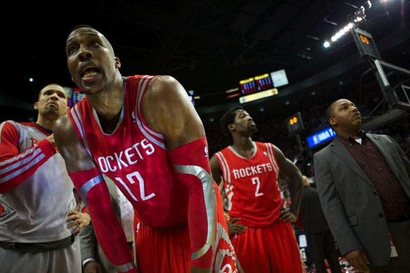 Houston star Dwight Howard and the Rockets react after losing Game 6 at Portland.