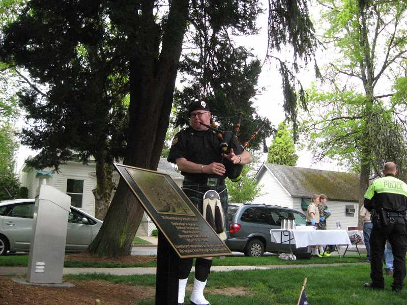 by: GAZETTE PHOTO: RAY PITZ - Tim Birr of the Tualatin Valley Fire & Rescue Bagpipers performs at the dedication of a bronze plaque in honor of former Sherwood Police Chief Delbert Stanislowski Saturday at Veteran's Park in Old Town Sherwood.