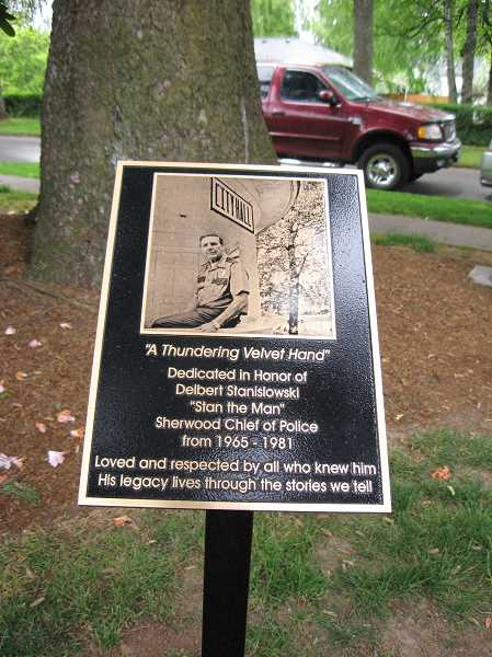 by: GAZETTE PHOTO: RAY PITZ - A plaque in honor of former Sherwood Police Chief Delbert Stanislowski, who served as chief between 1965 to 1981, police was unveiled May 3 in Veterans' Park.