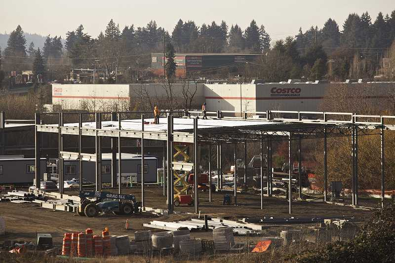 Crews continue construction of a new Walmart supercenter in Tigard. The world's largest retailer announced on Monday that it would hire about 300 employees at the store, and another 300 at its Sherwood store. Both stores are expected to open this summer.