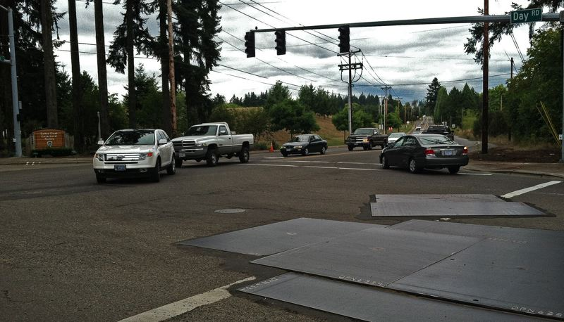 by: SPOKESMAN PHOTO: JOSH KULLA - The Basalt Creek planning area counts Day Road, shown here at its intersection with Grahams Ferry Road, as its southern boundary. The 600-acre area is being jointly planned for future development by Wilsonville and Tualatin.