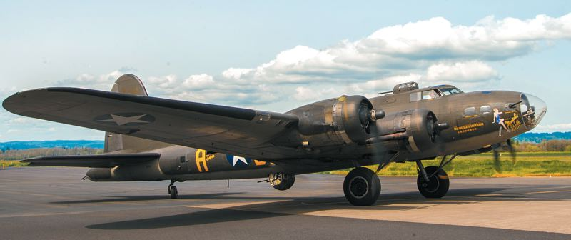 by: SPOKESMAN PHOTO: JOSH KULLA - The restored Boeing B-17 Memphis Belle taxis along the runway at Hillsboro Airport during a recent stop by the Liberty Foundation, the non-profit group that operates the plane and offers public flights.