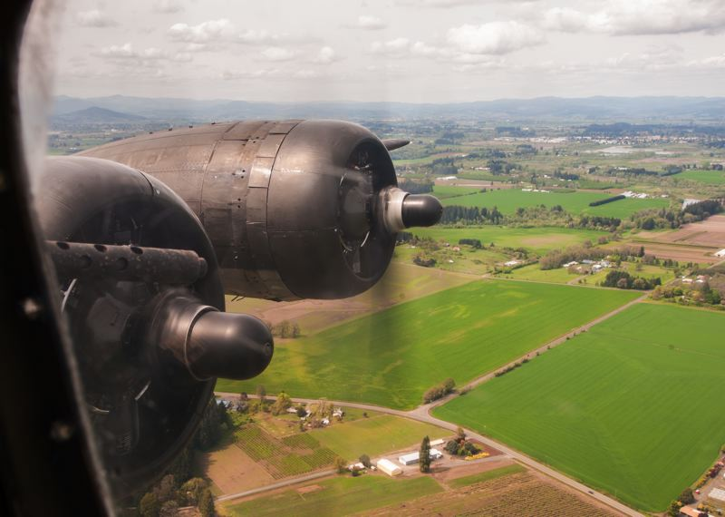 by: SPOKESMAN PHOTO: JOSH KULLA - The view out of a port side window over rural Washington County during a flight on the B-17 Memphis Belle.