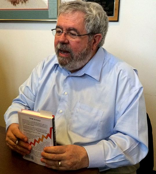 by: TRIBUNE PHOTO: PETER WONG - Journalist and author David Cay Johnston signed his book of essays  he edited, 'Divided: The Perils of Our Growing Inequality,' during a gathering in Salem.