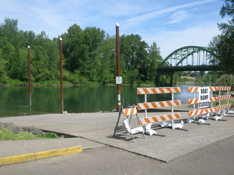by: PHOTO BY: RAYMOND RENDLEMAN - Closed signs and a barrier prevent people from using a damaged boat ramp in Clackamette Park to access the Clackamas River.