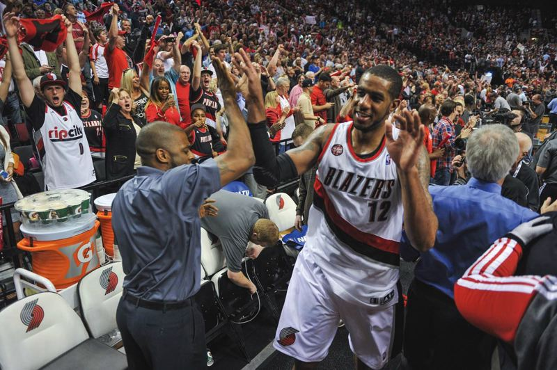 by: COURTESY OF JOHN LARIVIERE - Trail Blazers forward LaMarcus Aldridge is a happy NBA first-round series victor as he leaves the court at Moda Center after Game 6 against Houston.