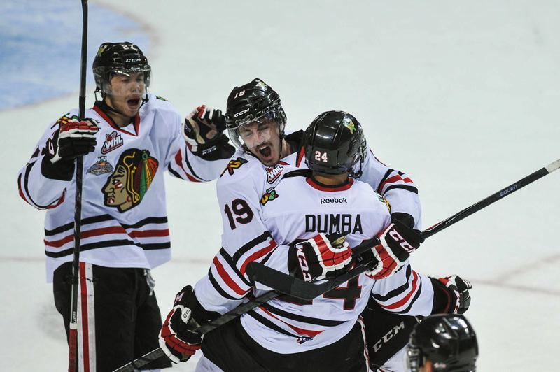 by: COURTESY OF JOHN LARIVIERE - Mathew Dumba (right) celebrates his second-period goal in Game 1 of the Western Hockey League finals with Portland Winterhawks teammates Oliver Bjorkstrand (left) and Nic Petan. Portland opened with a 5-2 win over the Edmonton Oil Kings.