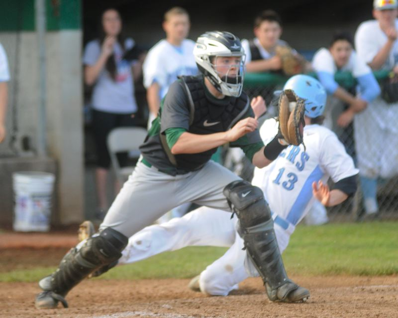 by: MATTHEW SHERMAN - West Linn catcher Chase Meyers records a force-out at home Monday during the Lions' 3-2 loss to Lakeridge.
