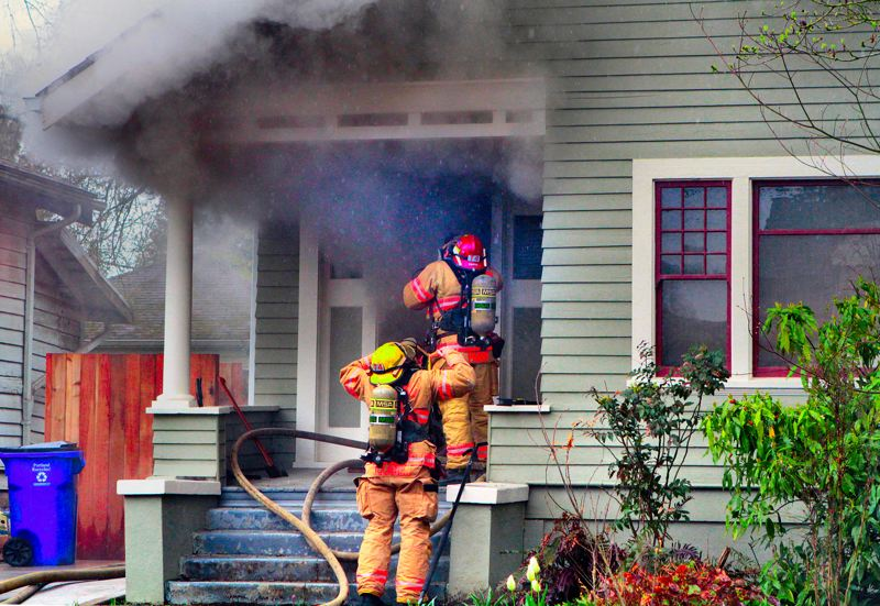 by: DAVID F. ASHTON - Opening the front door of this Eastmoreland house, Station 20 firefighters were confronted with thick smoke billowing out.