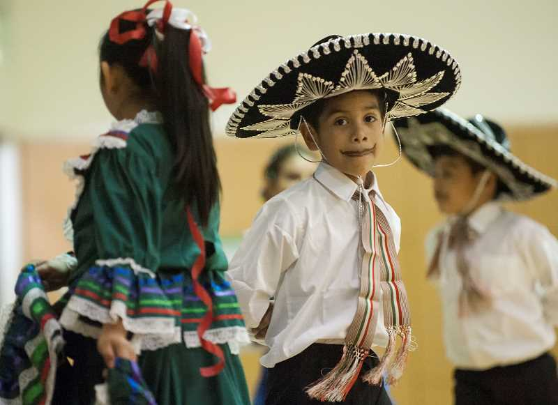 by: SPOKESMAN PHOTOS: JOSH KULLA - The boys performing with the Folklorico group, including David Hernandez, wore traditional costumes complete with moustaches for the performance.