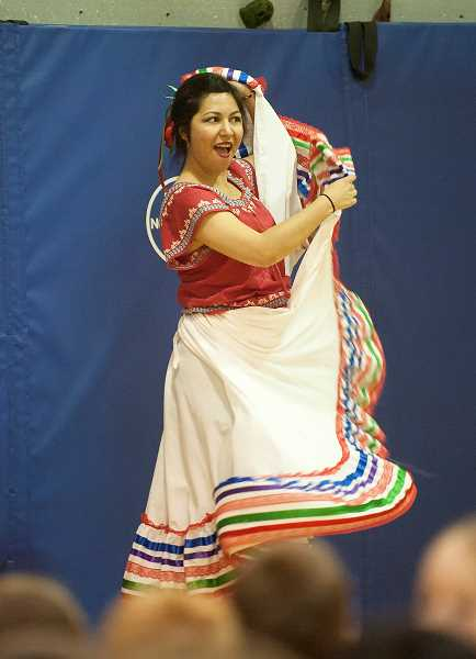 by: SPOKESMAN PHOTOS: JOSH KULLA - Boeckman Creek's world language teacher, Cynthia Munoz, performed a traditional Mexican folk dance as part of the schools Day of the Children celebration April 30.