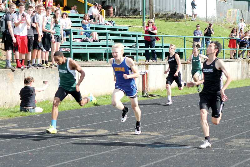 by: JIM BESEDA/MOLALLA PIONEER - Colton's Malik Knott (left) won the 100-meter dash with a hand-held time of 11.1 seconds, edging Gervais' Pieter Top and Westside Christian's Zijie Fu during Thursday's West Valley League meet at Colton High School.