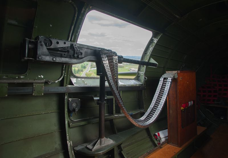 by: SPOKESMAN PHOTO: JOSH KULLA - A .50 caliber Browning machine was stationed on each side of the B-17 in the so-called waist position behind the wings.