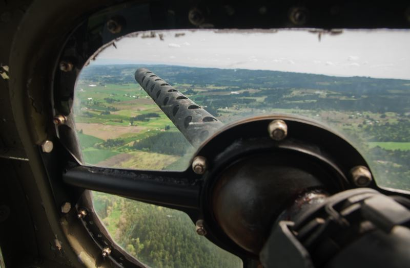 by: SPOKESMAN PHOTO: JOSH KULLA - The view out of port window in the nose section of the B-17 containing the 'cheek' machine gun.