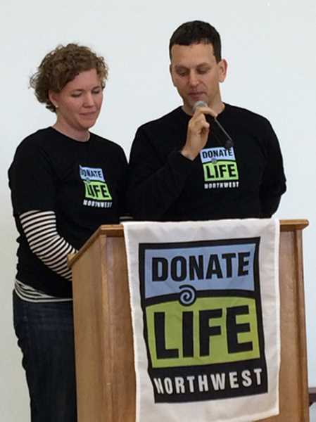 by: COURTESY PHOTO - Susan Dieter-Robinson and Tom Robinson wear Donate Life Northwest T-shirts with the slogan on the back: Ask me how to save a life! They spoke to about 130 people Saturday, encouraging them to become organ donors and to spread the word.