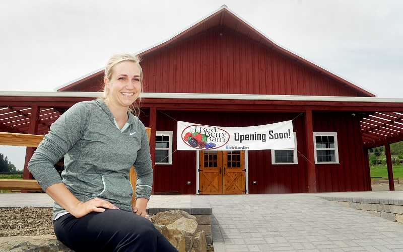 by: GARY ALLEN - New business - Erika Wilcotts, along with her husband Aaron, are opening the Red Berry Barn off Highway 99W. The barn specializes in u-pick berries and is slated to open Friday.