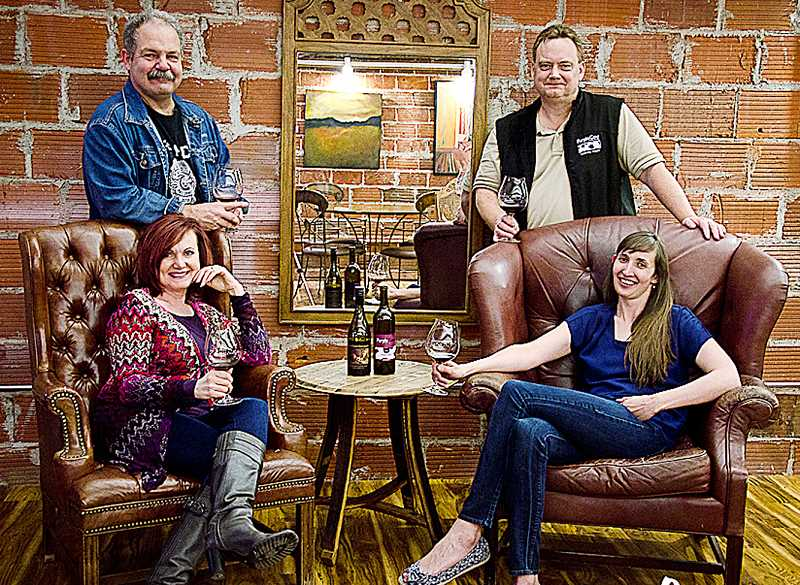 by: SUBMITTED PHOTO - Dual business - Purple Cow Vineyards has joined forces with Fox Farm Vineyards, opening a combined tasting room in Fox Farm's space on First Street.