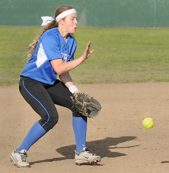 by: SETH GORDON - Clamp down - Freshman shortstop Paityn Willoughby fields a ground ball during Newberg's 9-8 win over Forest Grove April 30. The Tigers have won five of their past six games to ascend into third place in the Pacific Conference.