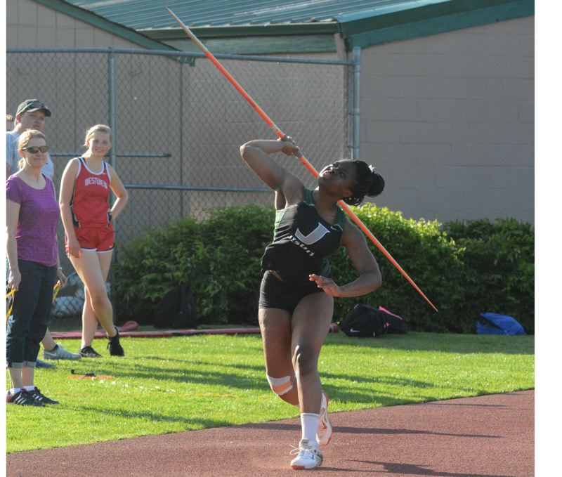 by: TIMES PHOTO: MATT SINGLEDECKER - Jesuit junior javelin thrower JoJo Ananouko threw 131 into the wind against Westview on May 1 to take first overall for the Crusaders.