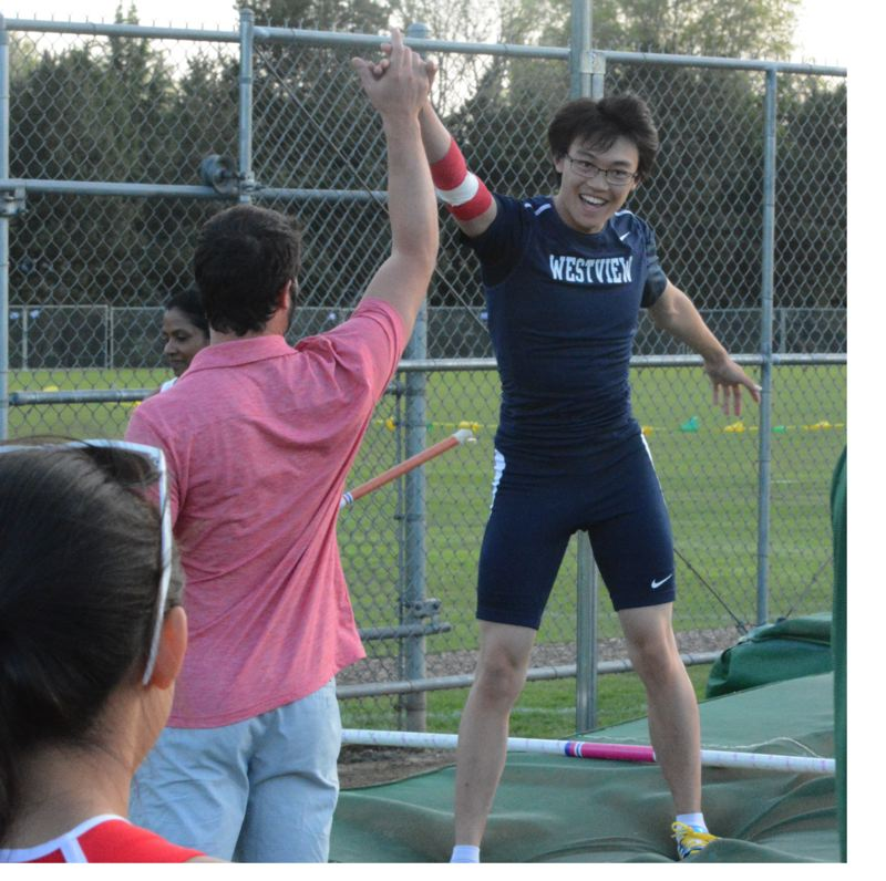 by: TIMES PHOTO: MATT SINGLEDECKER - Westview senior pole vaulter Austin Kwong celebrates his 12-06 seasonal best against Jesuit on May 1. Kwong has one of the best pole vault marks in Metro.
