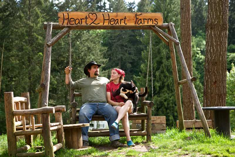 by: TIMES PHOTO: JAIME VALDEZ - Tyler and Elizabeth Boggs have run the no-chemicals Heart2Heart farm in Sherwood since 2010. The farm raises calves, chickens, hogs and other animals for slaughter, which it offers to local families.