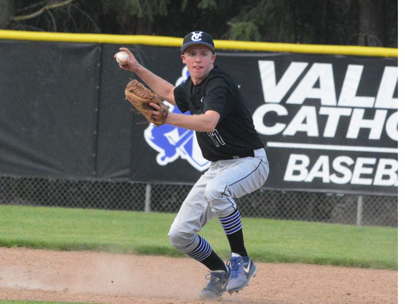by: TIMES PHOTO: MATT SINGLEDECKER - Valley Catholic shortstop Alex Hyland fields a ball on the infield dirt against Corbett during the Valiants 11-1 Lewis and Clark League win on Thursday.