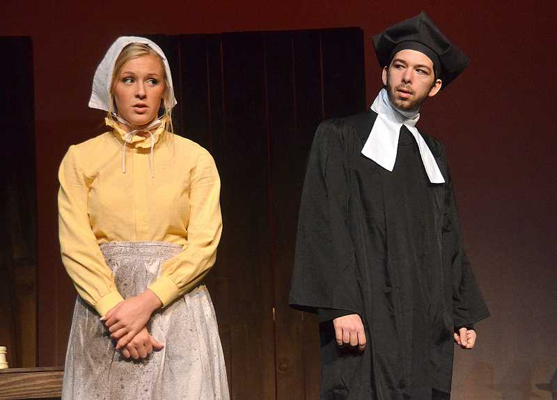 by: REVIEW PHOTO: VERN UYETAKE - Shelby Bylsma (Elizabeth Proctor), stands before Daniel Barber, who plays Judge Danforth in Lakeridge's upcoming play, 'The Crucible.'