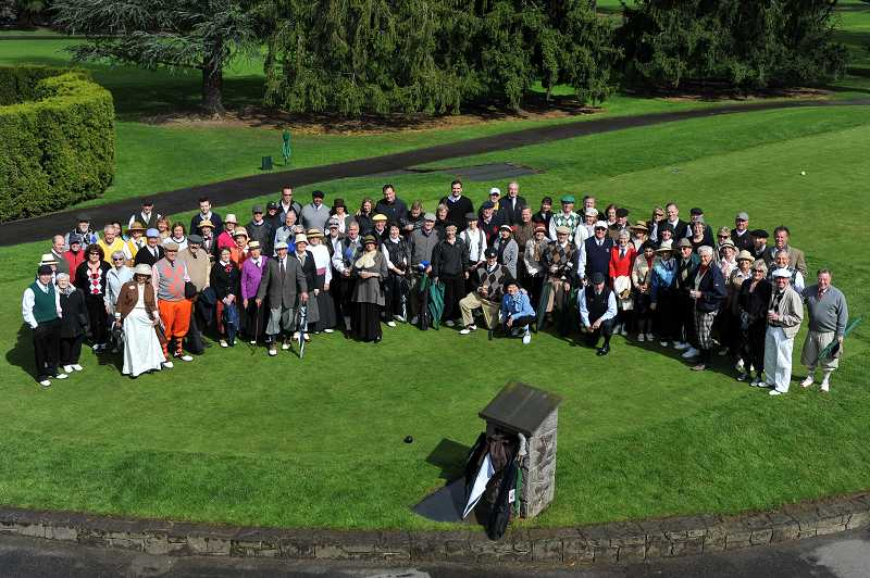 by: TIMES PHOTO: JOHN LARIVIERE - Portland Golf Club members gather for a group photo on the first tee prior to the beginning of a two-hole scramble on Sunday.
