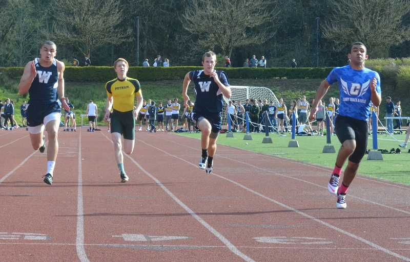 by: JEFF GOODMAN / PAMPLIN MEDIA GROUP - Devon Fortier (right), Timmy Johnson, Dominic Shorter and Noah Walker broke the Canby school record in the boys 400-meter relay with a time of 41.75 seconds May 2 at Jesuit High School.