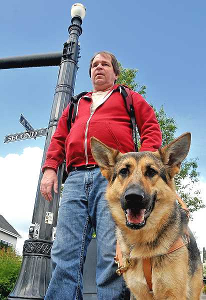 by: REVIEW PHOTO: VERN UYETAKE - Guide dog Hoda watches out for her new companion, Patrick Blaedorn of Lake Oswego.