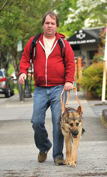 Becoming a familiar sight in downtown Lake Oswego are Patrick Blaedorn and his guidedog, Hoda.