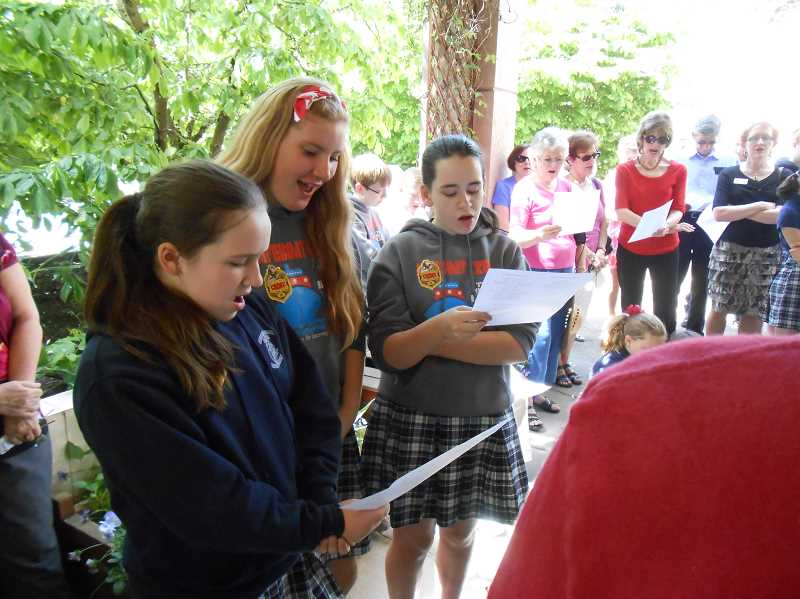 by: REVIEW PHOTO: CLIFF NEWELL - Students of the Leadership Class of Our Lady of Lake School played a major role in activities on National Prayer Day in Lake Oswego. From the left are Caitlin Gaffney, Eliesse Jakotich and Meaghan Andersen.