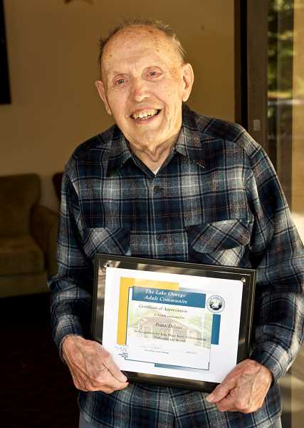 by: SUBMITTED PHOTO - Frank Delano holds the award he received for his longtime service to the Meals on Wheels program at the Lake Oswego Adult Community Center.