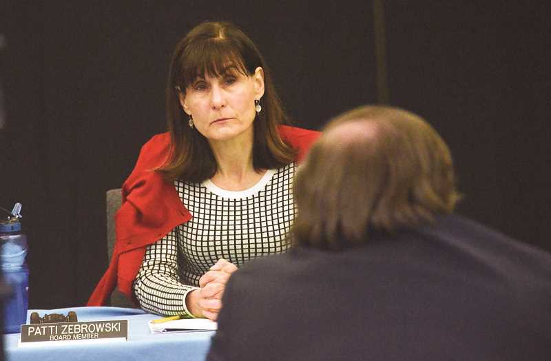 by: REVIEW PHOTO: VERN UYETAKE - Lake Oswego School Board Chairwoman Patti Zebrowski listens as Superintendent Bill Korach presents historical details on school capital improvement projects during a work session prior to a public hearing on Lakeridge stadium improvements Monday.