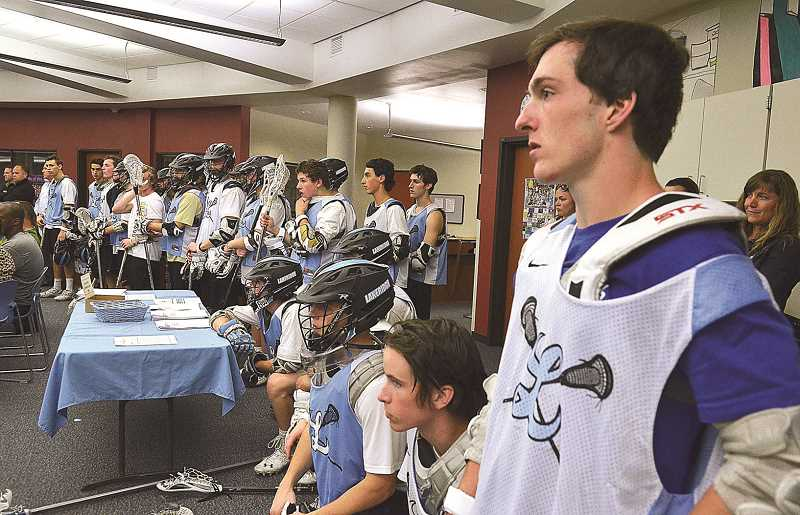 by: REVIEW PHOTO: VERN UYETAKE - Members of the Lakeridge lacrosse team attended the Lakeridge stadium upgrades public hearing in uniform, and a few of the players also spoke, including Holden Catlett, far right.