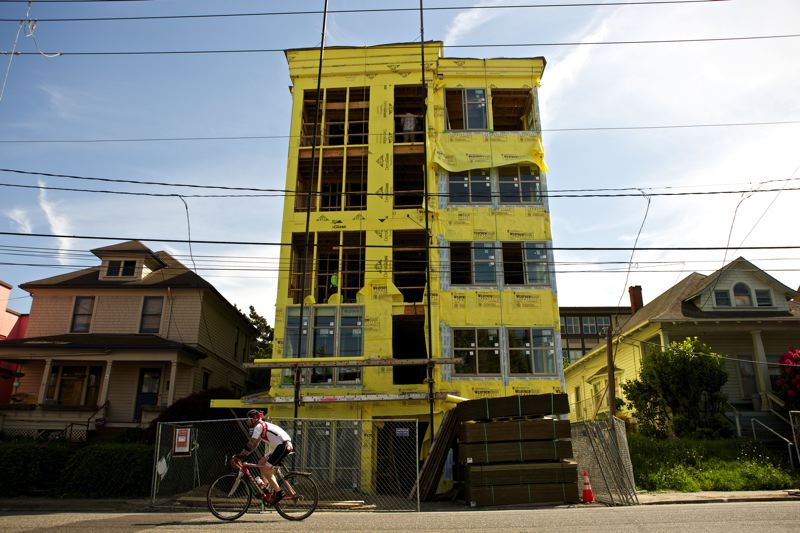 by: TRIBUNE PHOTO: JAIME VALDEZ - The footprint Thurman development is bringing micro apartments to Northwest Portland--50 units, shared kitchens, no on-site parking and rents significantly less than for studio apartments. Footprint CEO Cathy Reines predicts fewer than ten of the buildings residents will have cars.
