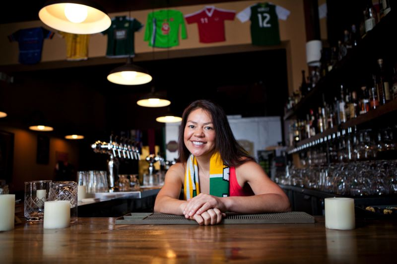 by: TRIBUNE PHOTO: ADAM WICKHAM - Hilda Stevens, owner of Bazi Bierbrasserie on Hawthorne, helped to spearhead the Kick Kick Score promotion that will lanch on MLS week in Portland in August. She and city leaders hope the All-Star Games benefits will spill into neighborhoods for the whole city to enjoy.