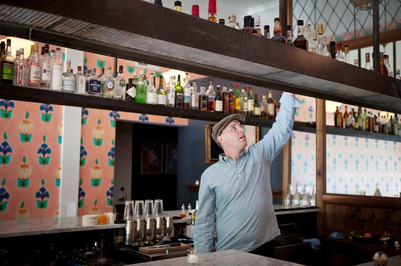 by: TRIBUNE PHOTOS: ADAM WICKHAM - Bartender Tim Davey works behind the bar at Angel Face, which offers drink consultations to fit your mood, taste and budget.