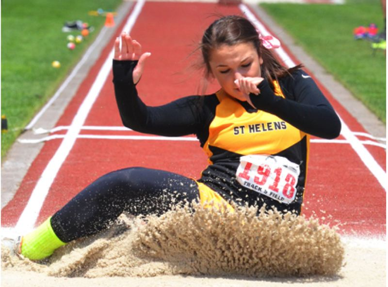 by: FILE PHOTO - Senior Kylie Reinholdt, pictured at the 2013 OSAA state championships in Eugene, snapped her own school record in the triple jump on Wednesday.