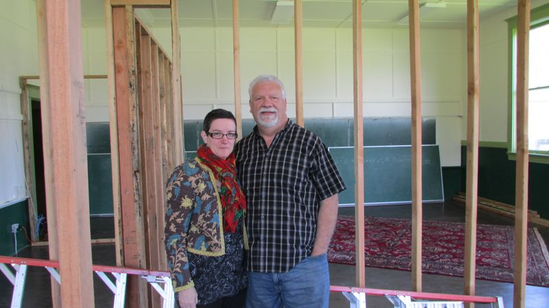 by: MARK MILLER - Jason Dunn (right) and Diane Johnson (left) stand in front of framework in one of the cavernous classrooms of the old Deer Island School. The couple plans to transform about half of the room, which Dunn said is nearly 1,000 square feet in size, into a master bedroom.