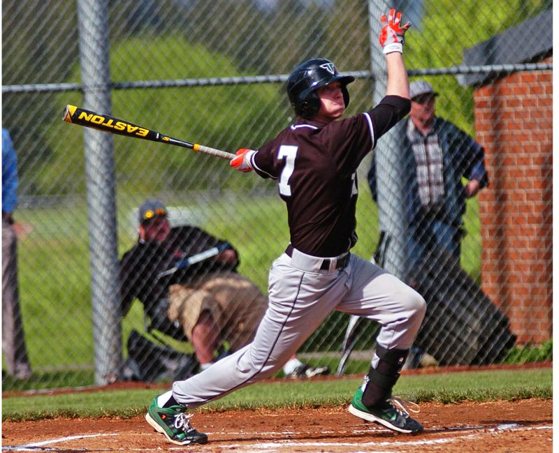 by: DAN BROOD - FOLLOW THROUGH -- Tigard senior Bruin Campbell takes a big cut during Tuesday's game at Tualatin.