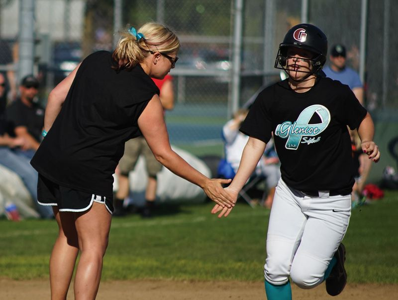 by: HILLSBORO TRIBUNE PHOTO: CHASE ALLGOOD - Glencoe softball players wore special black jerseys with teal ribbons and teal socks last Wednesday to support ovarian cancer awareness.