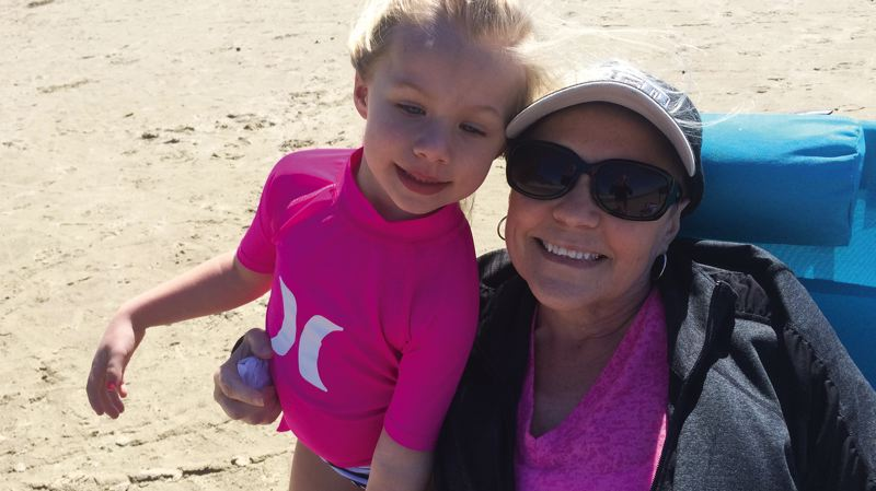 by: COURTESY PHOTO: JACY JUKKALA - Jacy Jukkala's daughter, Tenley, poses for a photo on the beach with Jukkala's sister, Julie Hiles, who is battling ovarian cancer.