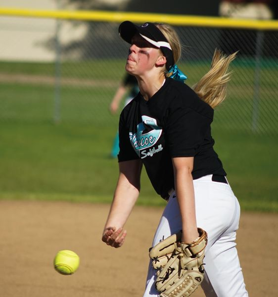by: HILLSBORO TRIBUNE PHOTO: CHASE ALLGOOD - Glencoe sophomore Tatum Becker delivers a pitch during last week's Pacific Conference softball game against city rival Hillsboro.