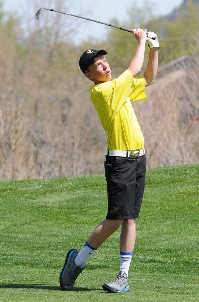 by: LON AUSTIN/CENTRAL OREGONIAN - Mayson Tibbs chips onto the first hole at Meadow Lakes Golf Course during a tournament earlier this year. Tibbs tied for medalist honors on Wednesday with a six-over-par round of 78 at Crosswater Golf Course in Sunriver.